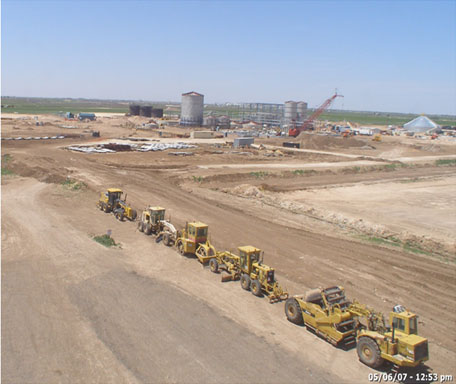 Contruction vehicles and equipment outside a plant in progress